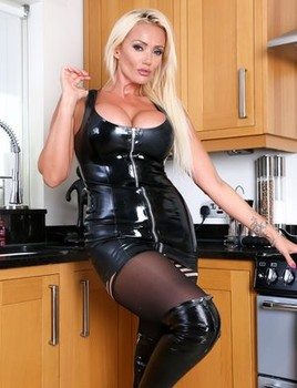 Blonde bombshell Lucy Zara takes a toy to her snatch in the kitchen