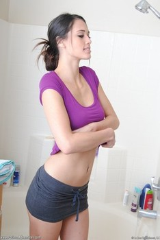 Solo girl Tiffany Thomson wets her hot body under a shower spray