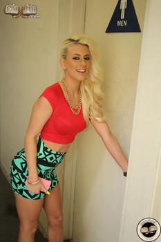 Slender blonde Jessie Volt undresses and eats a black gloryhole cock