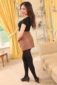 Marvelous brunette Alegra Thomas poses in smooth black tights and bra