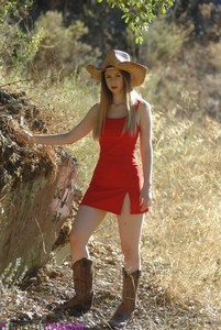 Glamour model Stella Cox removes her cowgirl attire until she's nakd