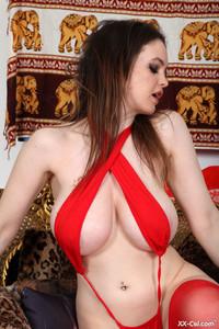 Amateur slut Megara Steele teasing with her big tits & curvy ass on a chair