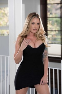 Tattooed MILF Teagan Presley showing off her fake tits & curvy ass