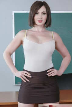 Smoking hot MILF Yasmin Scott unveils her big tits and round ass in the school