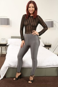 Hot redhead in transparent blouse Lucie Kent strips and poses in stockings