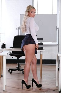 Buxom British student Amber Jade shows her tasty naked body in the classroom