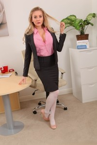 Stunning blonde secretary in stockings Charlie B presents big boobs in office
