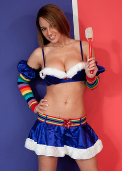 Erotic model Nikki Sims in rainbow knee socks and micro skirt teasing topless