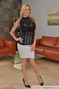 Mature caucasian female Alexis Fawx removes her tight skirt to pose naked