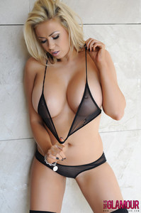 Hot blonde female freeing nice melons for see thru bra in black nylons