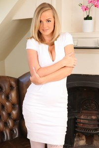 Adorable blonde Erica drops her tight dress and exposes awesome breasts