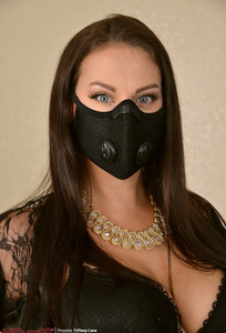 Beautiful 30 plus female Tiffany Cane wears a face mask while stripping naked