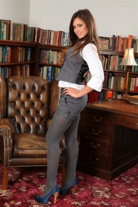 Gorgeous brunette Carla strips her uniform & poses in pantyhose in the library