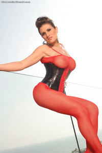 Sexy MILF Austin Kincaid flaunts her big boobs & rubs her twat in red fishnets