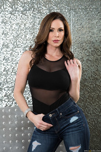 White American MILF Kendra Lust strips off her jeans and onesie to pose nude