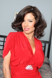 Middle-aged babe Veronica Avluv strips to stockings while in her bedroom