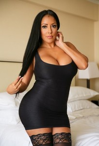 Latina Kiara Mia's tits are so huge, she can't keep them in her tight dress