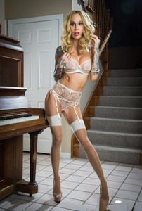 Blonde MILF Sarah Jessie shows sexy tattoos and body in white lingerie