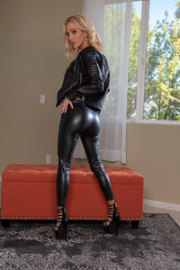 Alluring MILF in a latex outfit Alena Croft reveals her fakes and hot ass