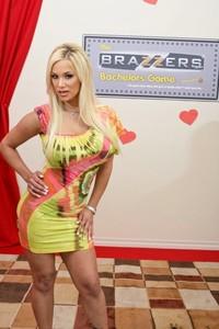 Blonde MILF Shyla Stylez doffs her dress and flaunts her massive breasts