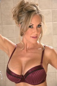 Mature wife with amazing fake tits Brandi Love showing off her hot soaped body