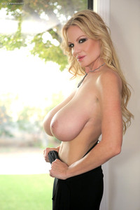 Busty MILF in black pants Kelly Madison parading her juicy knockers
