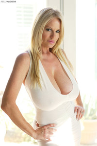 Sexy mature woman Kelly Madison rolls her white dress up & reveals tasty cunt