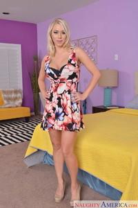 Platinum blonde MILF Katie Morgan crosses her nice legs after undressing