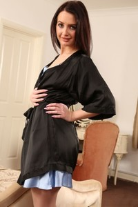 Lovely brunette Gina B loses silk nightgown and shows her booty in stockings