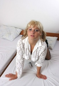 Busty blonde Malina May masturbates on her bed in crotchless pantyhose