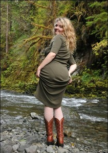 Mature lady Tasty Trixie strips naked on a rock in the river