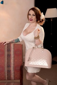 Pale redhead Lily Madison slowly frees her massive boobs from beneath clothes
