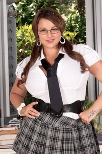 Fatty Terri Jane lets out her massive juggs after stripping her school uniform