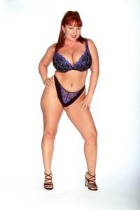 Curvy redhead Cherry Brady licks her oiled rack & sticks a toy in her vagina
