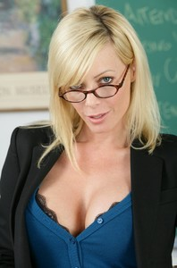 Blonde teacher Holly Sampson strips & flaunts big tits & shaved twat on a desk