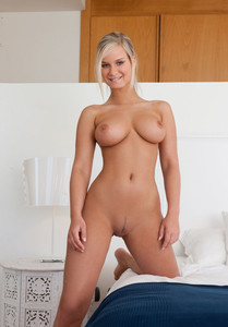 Big titted hot blonde Miela naked on her knees showing off her firm small ass