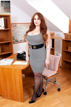 Fat redhead secretary Yola Flimes strips to her stockings while at her desk