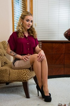 Skinny blonde American Karla Kush strips to sexy stockings in a solo