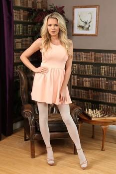Blonde stunner Porchia W grabs her big fake tits while posing in pantyhose