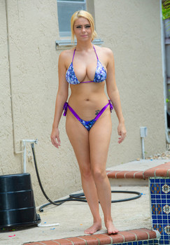 Blonde amateur Kylie K sets her great body free of a bikini next to a pool