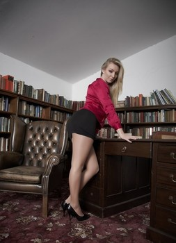 Natural blond female Hayley Marie Coppin removes her miniskirt to pose in hose
