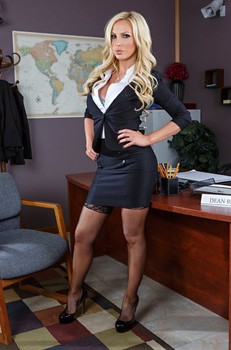 Sizzling blonde secretary Nikki Benz sheds her suit to pose in hot lingerie