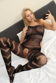 Hot blonde Nathaly Cherie takes selfies in the sexiest of crotchless stockings