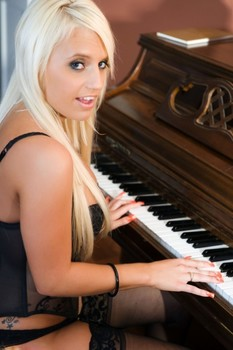 Hot blonde Jacky Joy exposes her tits and twat after playing the piano