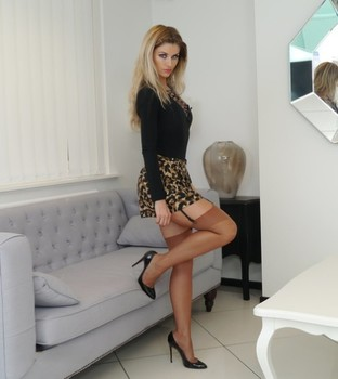 Sol model Kathryn shows bare thighs while posing in tan nylons and garters