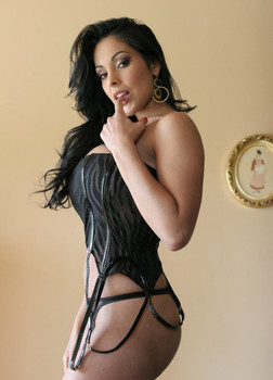 Alluring MILF pornstar Mercedez removes lingerie for nude posing