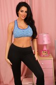 Black haired cougar Charley S displays her huge bosoms and poses in a solo