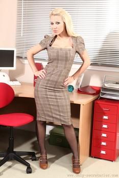 Blonde MILF Morgan drops her plaid dress and exposes big fake breasts