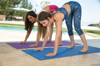 Buxom MILF Kendra Lust seduces yoga instructor Riley Reid for hot girl on girl