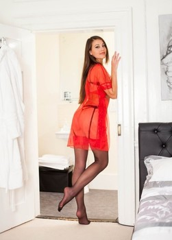 Leggy solo model Lorena G showcases her bald cunt in sexy nylons